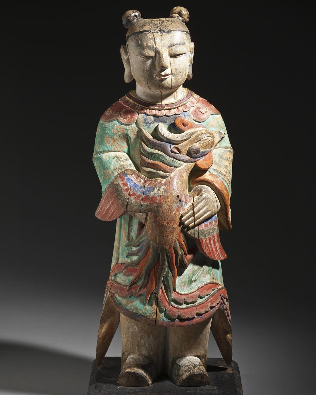 The carved figure …